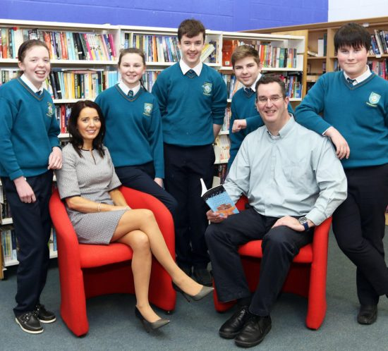 Two teachers with students in a library